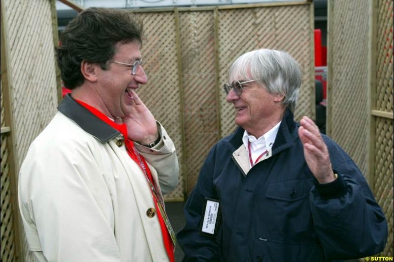 Bernie Ecclestone, F1 Supremo, chats to Louis Camilleri, Chairman of Philip Morris Group. Canadian Grand Prix, Montreal, Saturday, June 14th 2003.