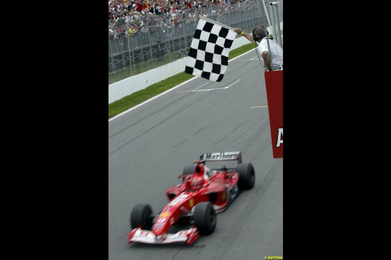 Michael Schumacher, Ferrari, crosses the line to take victory. Canadian Grand Prix, Montreal, Sunday, June 15th 2003.