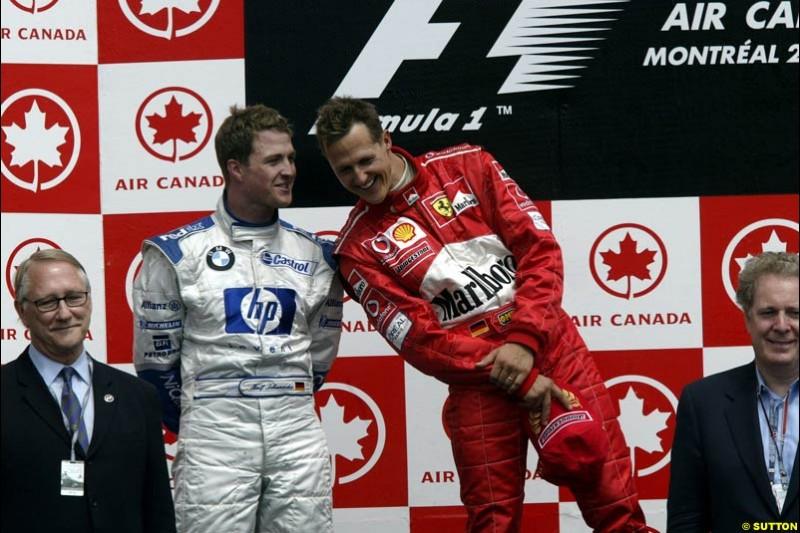 Michael Schumacher, Ferrari, 1st, chats with Ralf Schumacher, Williams, 2nd. Canadian Grand Prix, Montreal, Sunday, June 15th 2003.