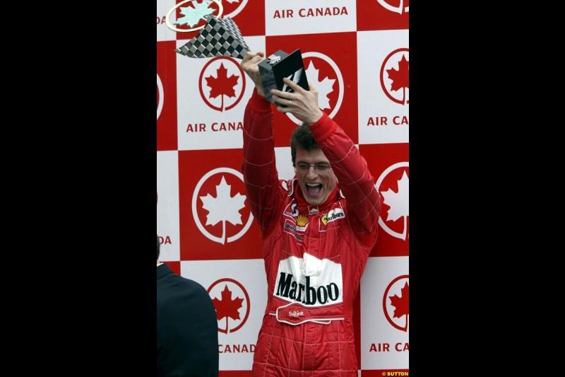 Race Engineer Chris Dyer, Ferrari, celebrates the team victory. Canadian Grand Prix, Montreal, Sunday, June 15th 2003.