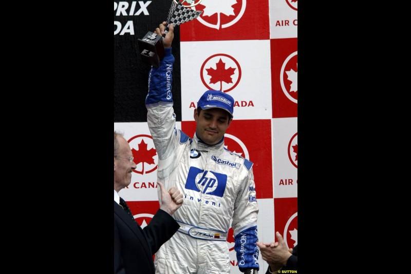 Juan Pablo Montoya, Williams, celebrates third place. Canadian Grand Prix, Montreal, Sunday, June 15th 2003.