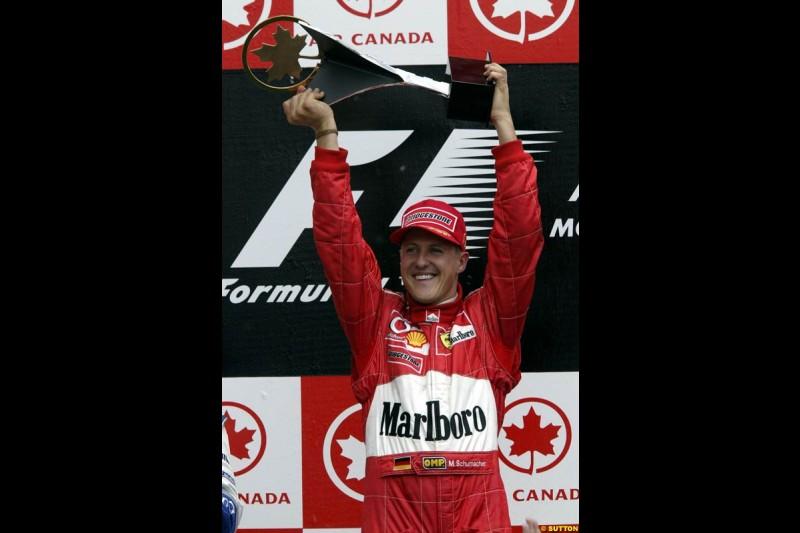 Michael Schumacher, Ferrari, celebrates victory. Canadian Grand Prix, Montreal, Sunday, June 15th 2003.