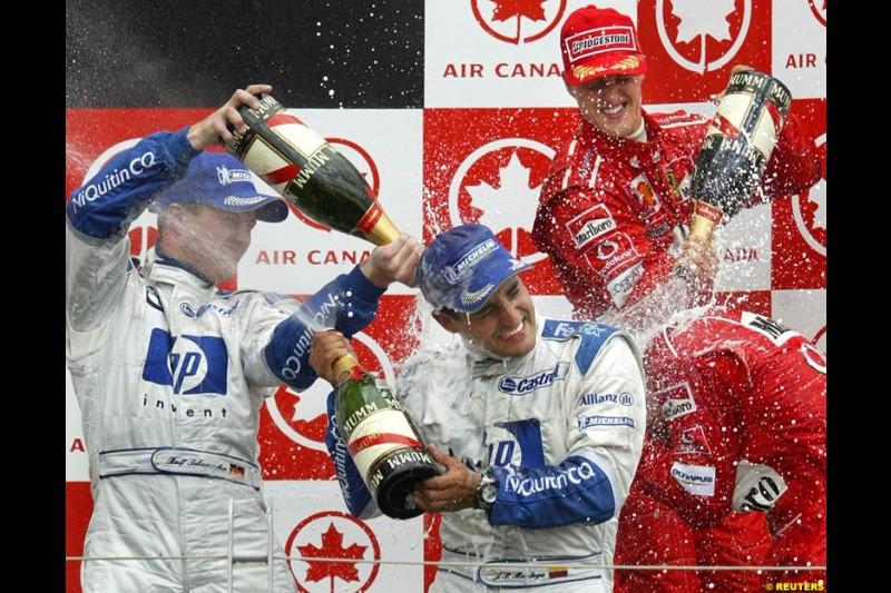 The Podium. 1st, Michael Schumacher, Ferrari; 2nd, Ralf Schumacher, Williams; 3rd, Juan Pablo Montoya, Williams. Canadian Grand Prix, Montreal, Sunday, June 15th 2003.