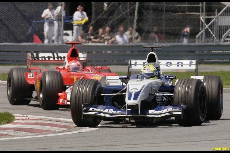 Ralf Schumacher, Williams, leads Michael Schumacher, Ferrari. Canadian Grand Prix, Montreal, Sunday, June 15th 2003.