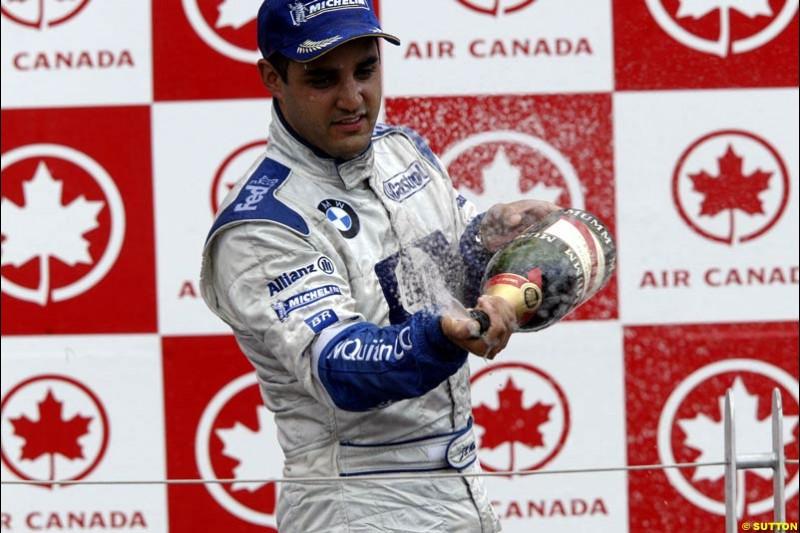 The Podium. Juan Pablo Montoya, Williams, celebrates third place. Canadian Grand Prix, Montreal, Sunday, June 15th 2003.