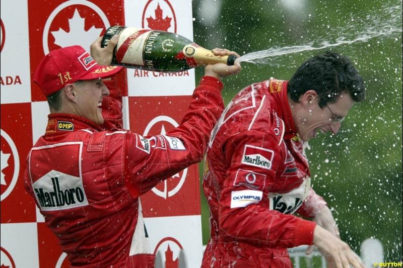 The Podium. Michael Schumacher, Ferrari, celebrates victory with race engineer, Chris Dyer. Canadian Grand Prix, Montreal, Sunday, June 15th 2003.