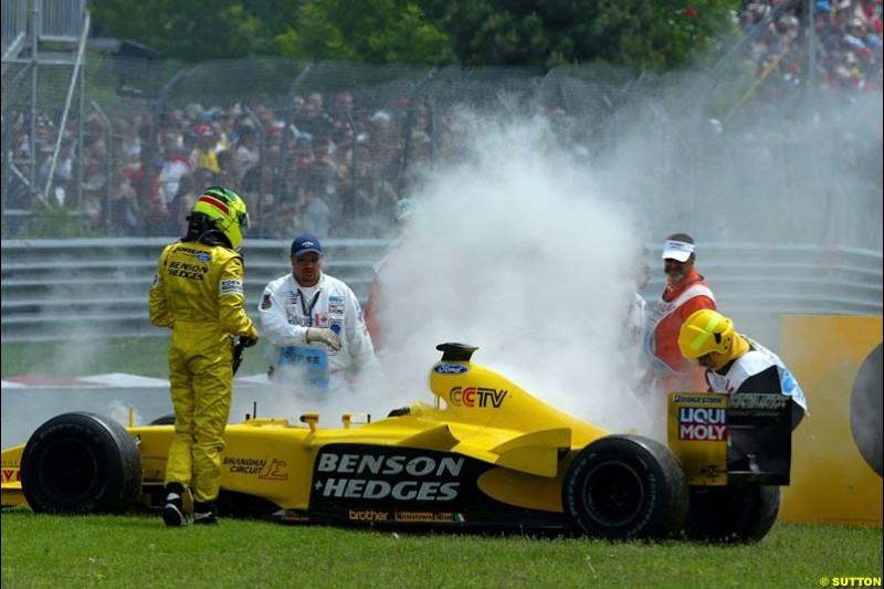 Ralph Firman Jnr, Jordan, stands next to his car after a mechanical failure. Canadian Grand Prix, Montreal, Sunday, June 15th 2003.