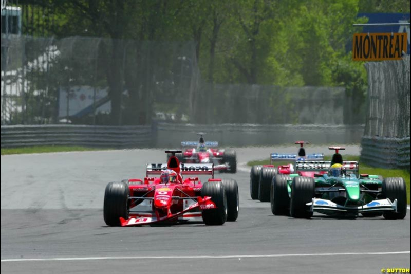 Rubens Barrichello, Ferrari, holds off the field as he limps to the pits with a broken front wing. Canadian Grand Prix, Montreal, Sunday, June 15th 2003.
