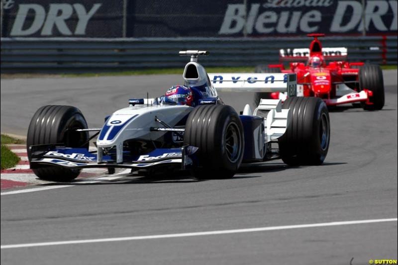 Juan Pablo Montoya, Williams, followed by Michael Schumacher, Ferrari. Canadian Grand Prix, Montreal, Sunday, June 15th 2003.