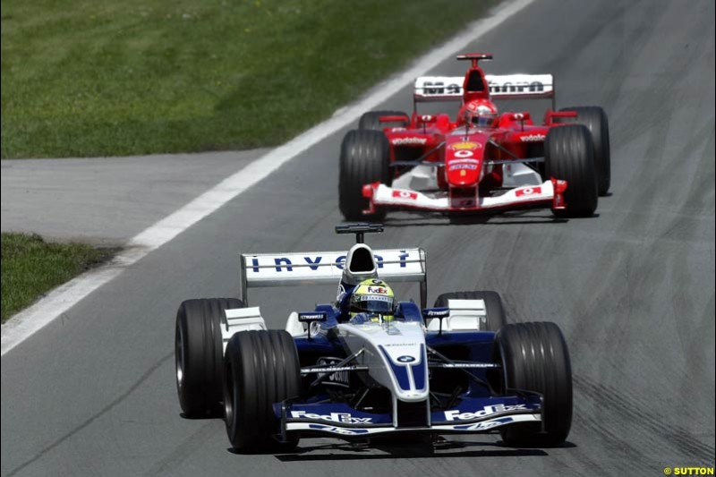 Ralf Schumacher, Williams, leads brother Michael Schumacher, Ferrari. Canadian Grand Prix, Montreal, Sunday, June 15th 2003.