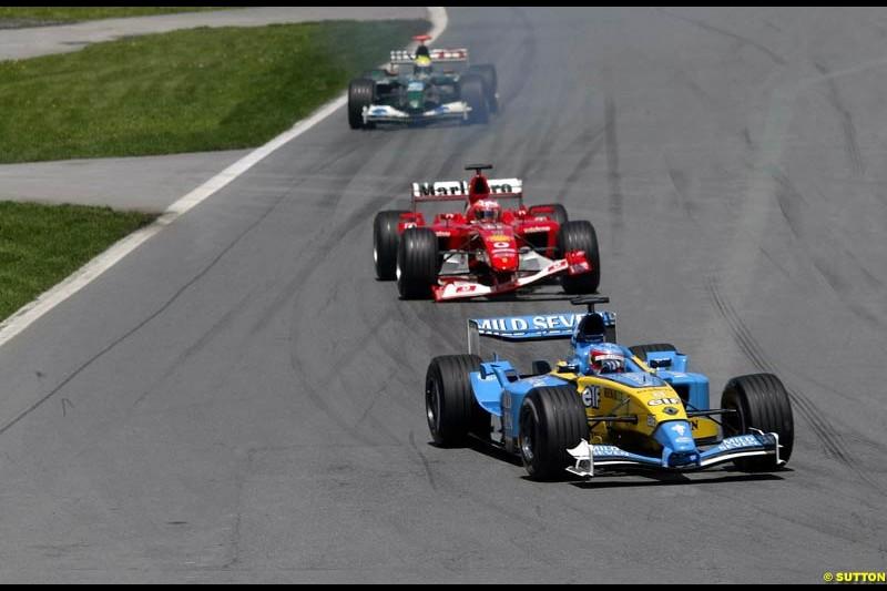 Fernando Alonso, Renault, leads Rubens Barrichello, Ferrari. Canadian Grand Prix, Montreal, Sunday, June 15th 2003.