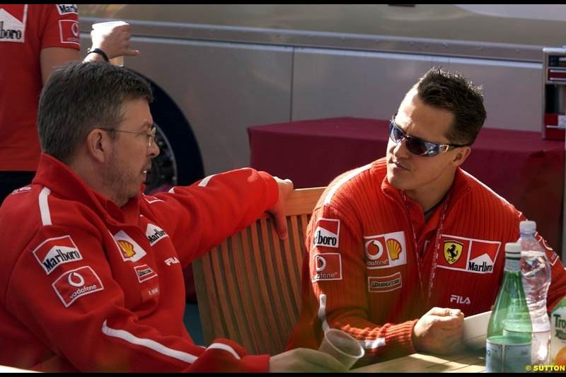 Michael Schumacher, Ferrari, chats to Ross Brawn, Ferrari Technical Director. Canadian Grand Prix, Montreal, Sunday, June 15th 2003.