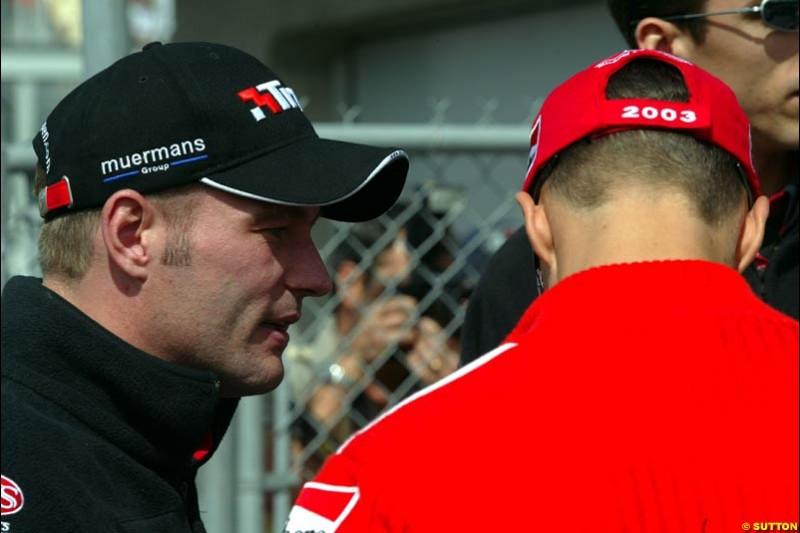 Jos Verstappen, Minardi, chats to Michael Schumacher, Ferrari. Canadian Grand Prix, Montreal, Sunday, June 15th 2003.