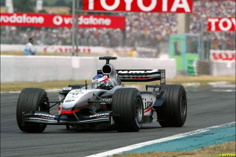 Kimi Raikkonen, McLaren. French Grand Prix at Magny Cours. Circuit de Nevers, France. Sunday, July 6th 2003.