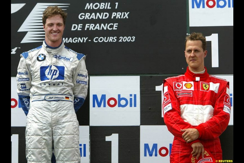 Ralf Schumacher, Williams, along side brother Michael Schumacher, Ferrari. French Grand Prix at Magny Cours. Circuit de Nevers, France. Sunday, July 6th 2003.