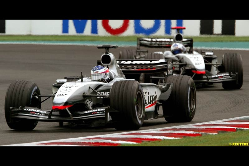 Kimi Raikkonen, McLaren, leads team mate David Coulthard. French Grand Prix at Magny Cours. Circuit de Nevers, France. Sunday, July 6th 2003.
