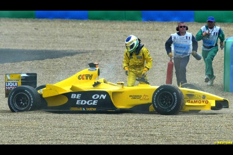 Giancarlo Fisichella, Jordan, steps out of his car. French Grand Prix at Magny Cours. Circuit de Nevers, France. Sunday, July 6th 2003.