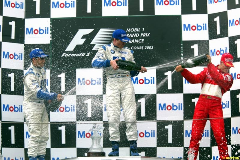 The Podium. 1st, Ralf Schumacher, Williams; 2nd, Juan Pablo Montoya, Williams; 3rd, Michael Schumacher, Ferrari. French Grand Prix at Magny Cours. Circuit de Nevers, France. Sunday, July 6th 2003.