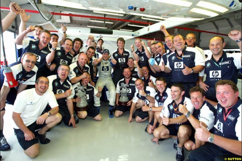 The Williams team celebrates. French Grand Prix at Magny Cours. Circuit de Nevers, France. Sunday, July 6th 2003.