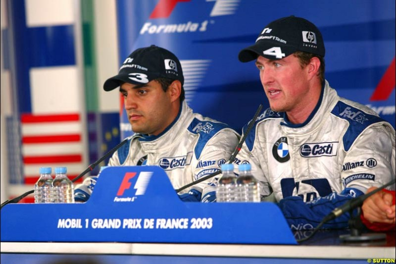 Ralf Schumacher, Williams, along side team mate Juan Pablo Montoya, Williams. French Grand Prix at Magny Cours. Circuit de Nevers, France. Sunday, July 6th 2003.