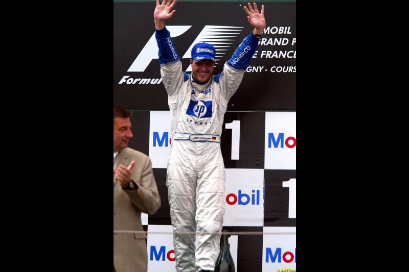 Ralf Schumacher, Williams, celebrates victory. French Grand Prix at Magny Cours. Circuit de Nevers, France. Sunday, July 6th 2003.