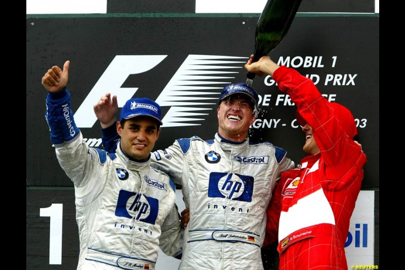 The podium of the French Grand Prix at Magny Cours. Circuit de Nevers, France. Sunday, July 6th 2003.