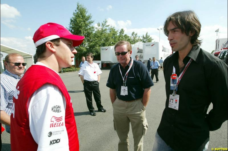 Olivier Panis with footballer Robert Pirez. French Grand Prix at Magny Cours, France. Sunday, July 6th 2003.