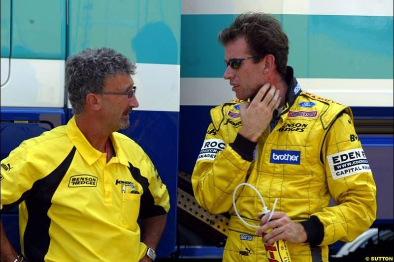 Eddie Jordan, Jordan Team Principle, chats to driver Ralph Firman Jnr. German Grand Prix, Hockenheim, Germany. Saturday, August 2nd 2003.
