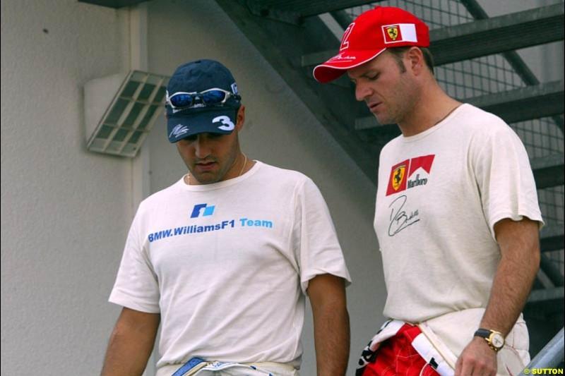 Juan Pablo Montoya, Williams, with Rubens Barrichello, Ferrari. German Grand Prix, Hockenheim, Germany. Saturday, August 2nd 2003.