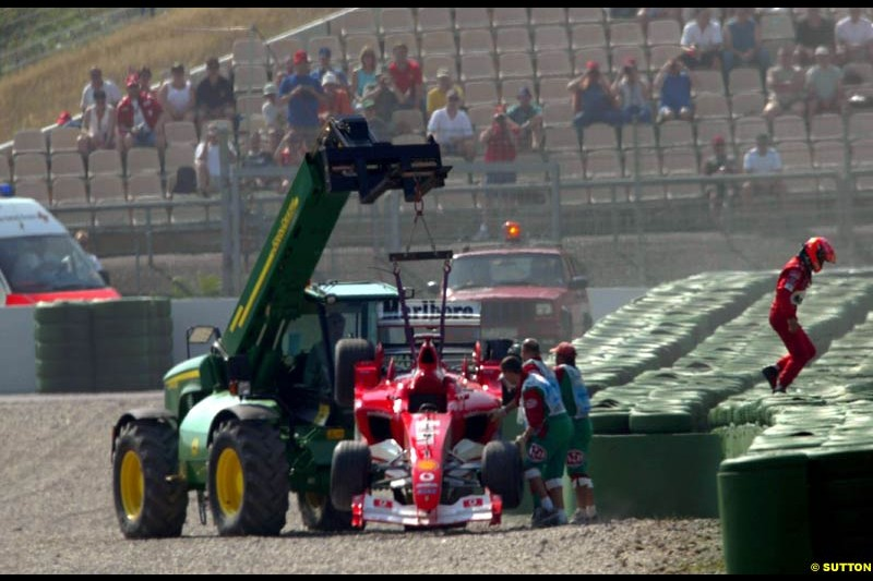 Michael Schumacher's Ferrari lifted away after he crashed during practice. German Grand Prix, Hockenheim, Germany. Saturday, August 2nd 2003.