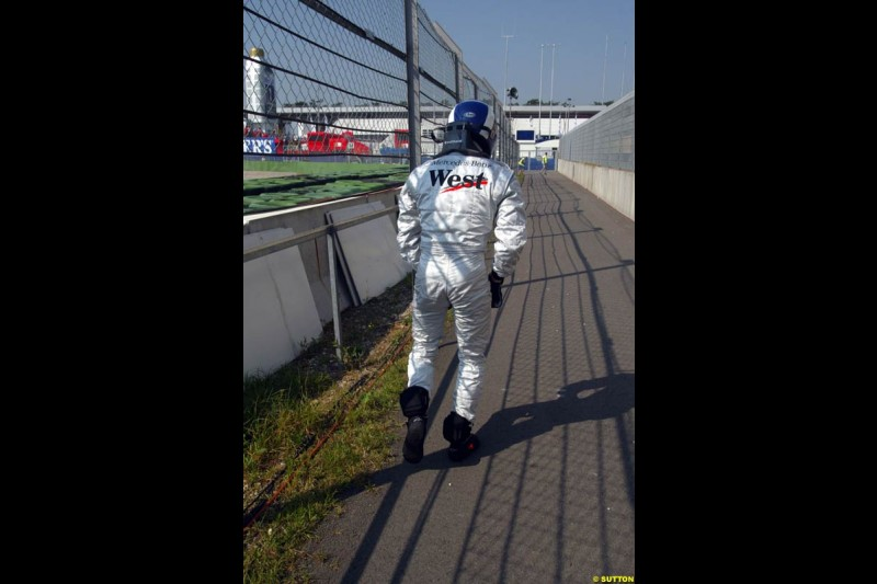 David Coulthard runs back to the pits after he crashed during practice. German Grand Prix, Hockenheim, Germany. Saturday, August 2nd 2003.