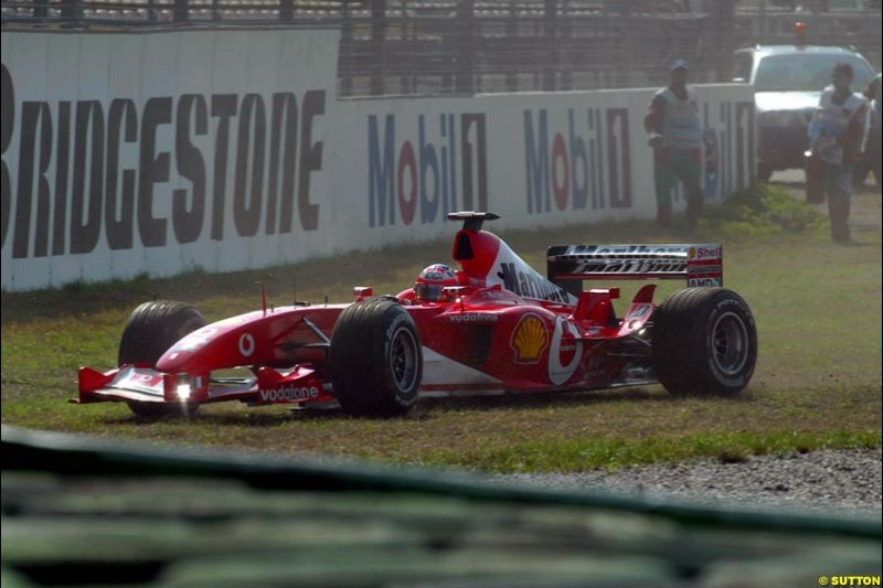 Rubens Barrichello, Ferrari, runs wide during practice. German Grand Prix, Hockenheim, Germany. Saturday, August 2nd 2003.