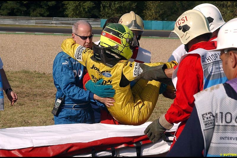 Ralph Firman Jnr, Jordan, is helped after crashing out of Free Practice. Hungarian Grand Prix Saturday. Hungaroring, Budapest. 23rd August, 2003.