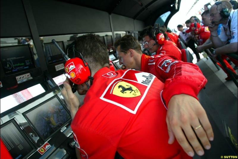 Michael Schumacher, Ferrari, with the Ferrari pit wall crew. Hungarian Grand Prix Saturday. Hungaroring, Budapest. 23rd August, 2003.