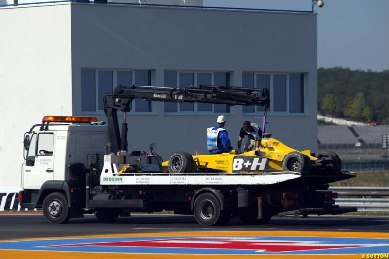 The car of Ralph Firman Jnr is recovered. Hungarian Grand Prix Saturday. Hungaroring, Budapest. 23rd August, 2003.