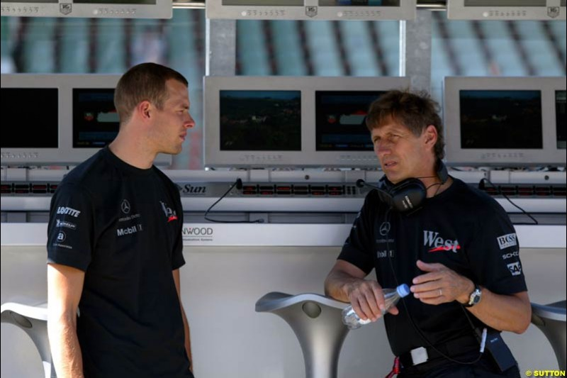 McLaren Test Driver Alex Wurz talks to Mario Illien, Ilmor Engine Designer. Hungarian Grand Prix Saturday. Hungaroring, Budapest. 23rd August, 2003.