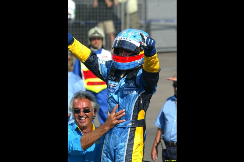 Fernando Alonso, Renault, celebrates victory. Hungarian Grand Prix Sunday. Hungaroring, Budapest. 24th August, 2003.