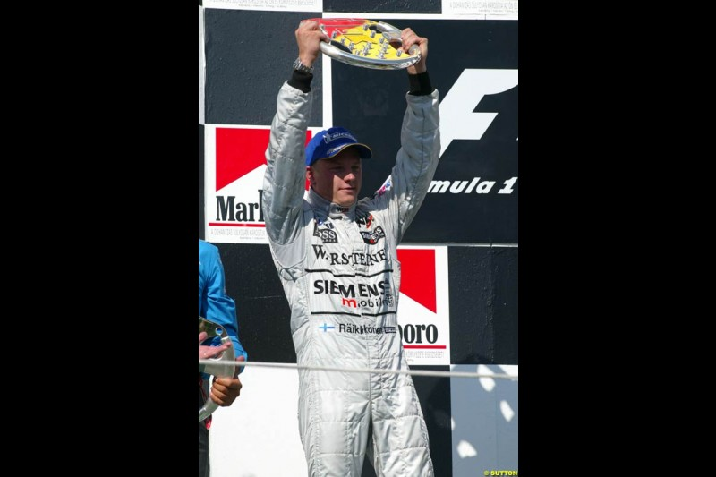 Kimi Raikkonen, McLaren, celebrates on the podium. Hungarian Grand Prix Sunday. Hungaroring, Budapest. 24th August, 2003.