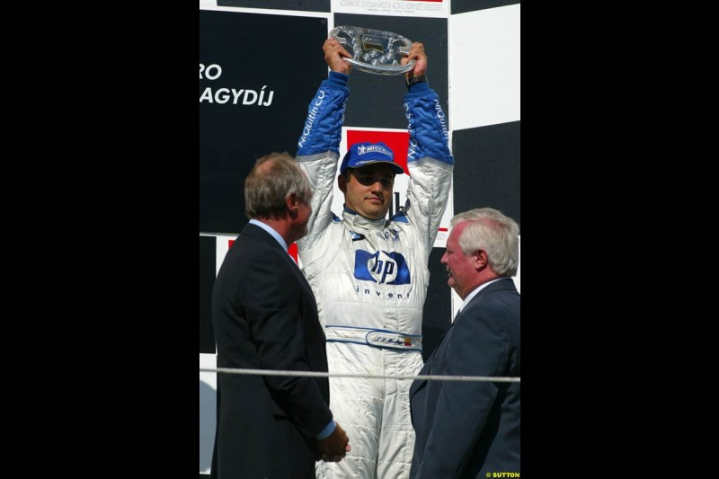Juan Pablo Montoya, Williams, celebrates on the podium. Hungarian Grand Prix Sunday. Hungaroring, Budapest. 24th August, 2003.