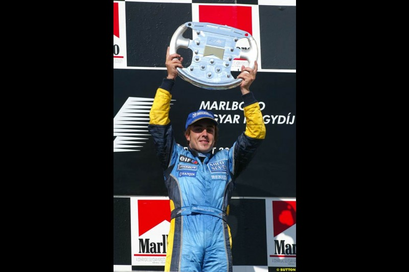 Fernando Alonso, Renault, celebrates on the podium. Hungarian Grand Prix Sunday. Hungaroring, Budapest. 24th August, 2003.