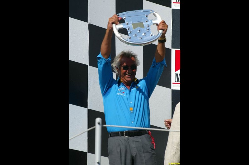 Flavio Briatore, Renault Team Principle, celebrates on the podium. Hungarian Grand Prix Sunday. Hungaroring, Budapest. 24th August, 2003.