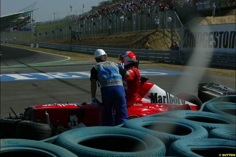 Rubens Barrichello, Ferrari, steps out of his car after crashing out. Hungarian Grand Prix Sunday. Hungaroring, Budapest. 24th August, 2003.