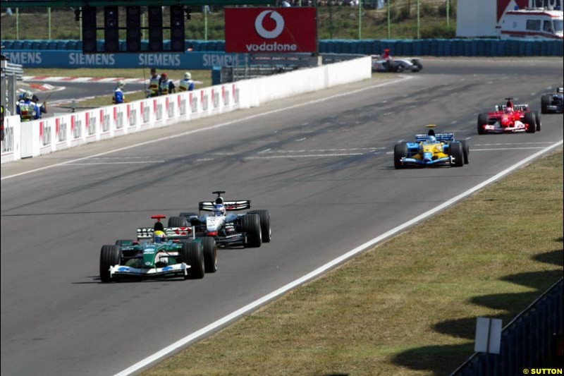 Mark Webber, Jaguar, followed by Kimi Raikkonen, McLaren. Hungarian Grand Prix Sunday. Hungaroring, Budapest. 24th August, 2003.