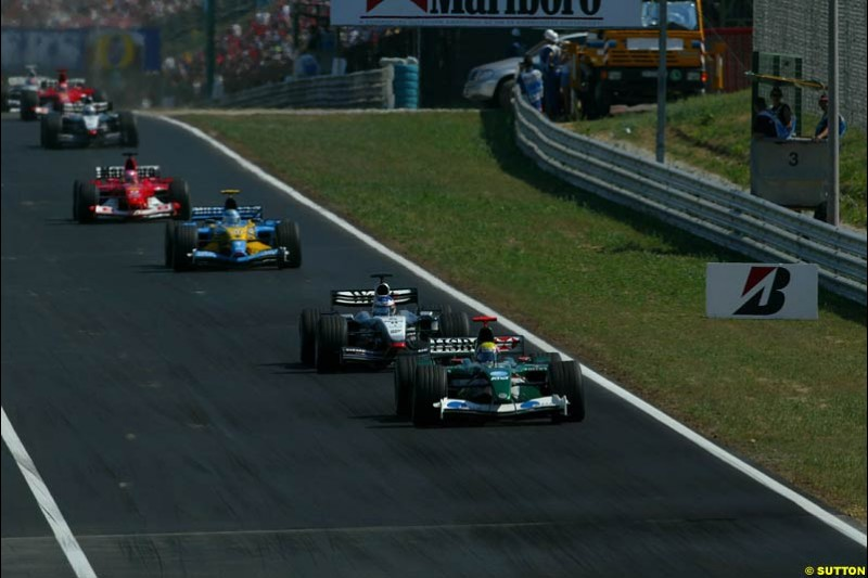 Mark Webber, Jaguar, leads the rest of the field. Hungarian Grand Prix Sunday. Hungaroring, Budapest. 24th August, 2003.