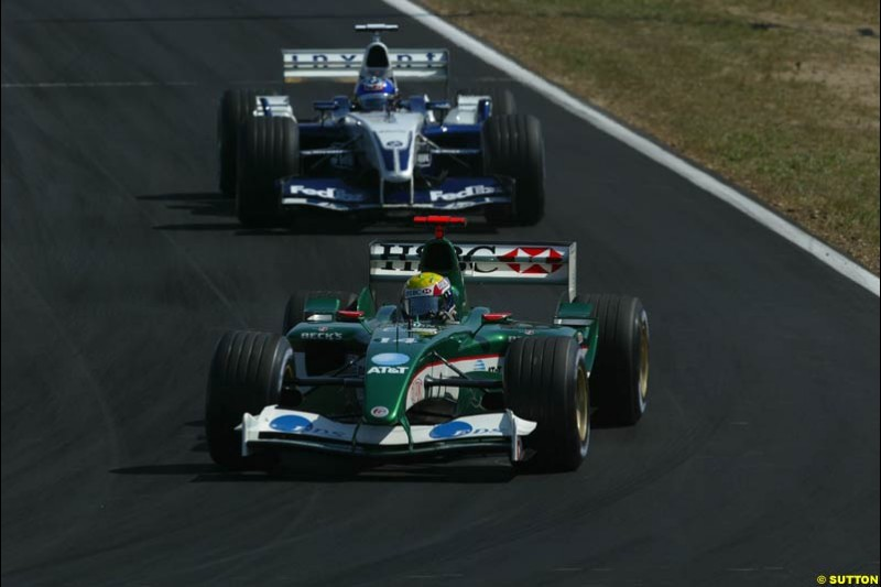 Mark Webber, Jaguar, holds off Juan Pablo Montoya, Williams. Hungarian Grand Prix Sunday. Hungaroring, Budapest. 24th August, 2003.