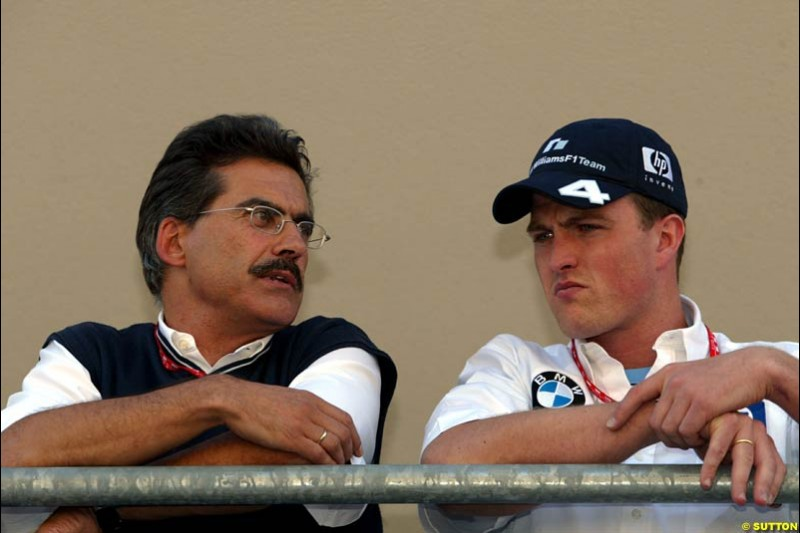 Mario Theissen and Ralf Schumacher. United States GP, Indianapolis Motor Speeway. Thursday, September 25th 2003.