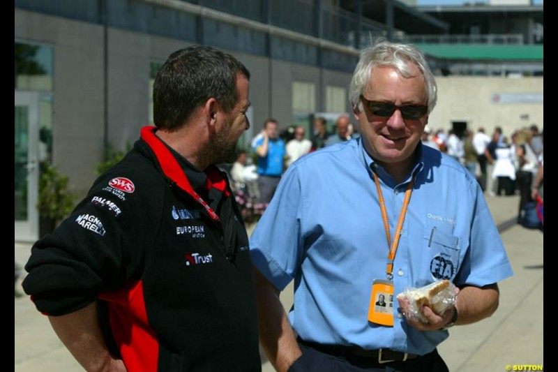 Paul Stoddart and Charlie Whiting. United States GP, Indianapolis Motor Speeway. Thursday, September 25th 2003.