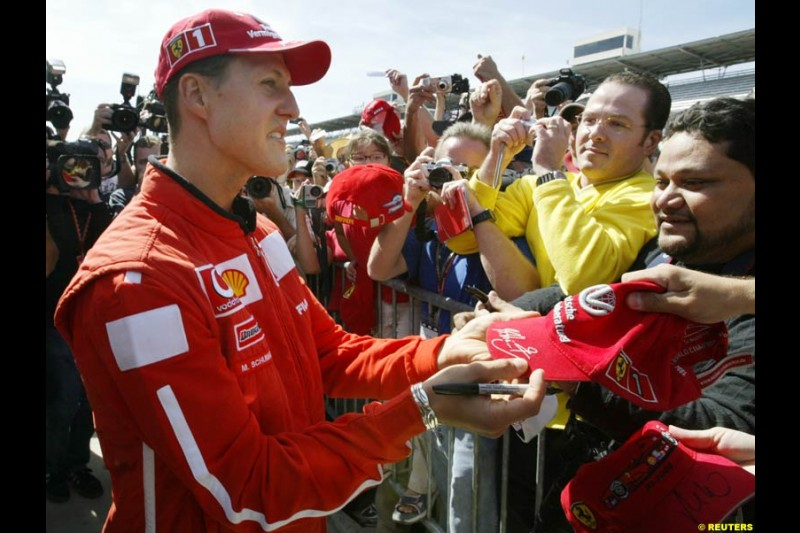 Ferrari's Michael Schumacher with the fans. United States GP, Indianapolis Motor Speeway. Thursday, September 25th 2003.