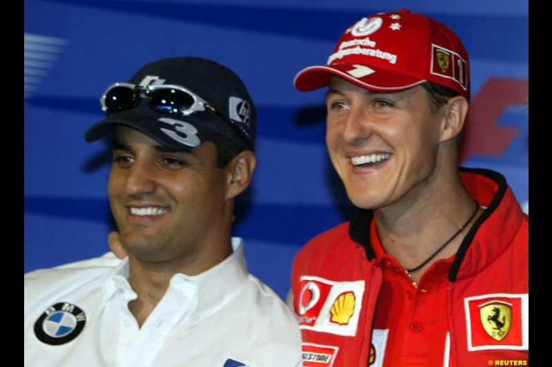 Juan Pablo Montoya and Michael Schumacher. United States GP, Indianapolis Motor Speeway. Thursday, September 25th 2003.