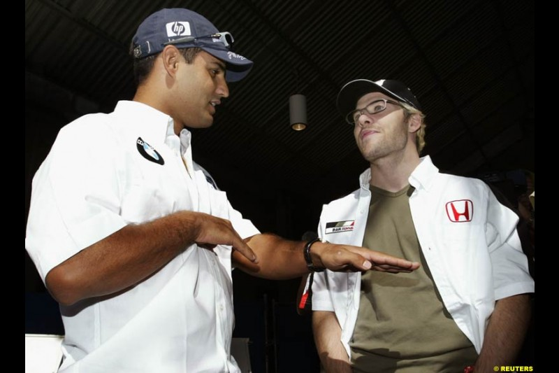 Williams driver Juan Pablo Montoya with BAR driver Jacques Villeneuve. United States GP, Indianapolis Motor Speeway. Thursday, September 25th 2003.